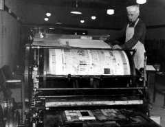 At left the late Roy M. Chatters, Museum founder, demonstrates the 2-1/2 ton flat-bed press. The last edition of the Palouse Republic printed on this machine still remains on the press.