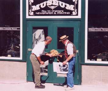 Mayor Michael Echanove and Bob West cut the ribbon to officially re-open the Museum to the public on Palouse Day 2003.
